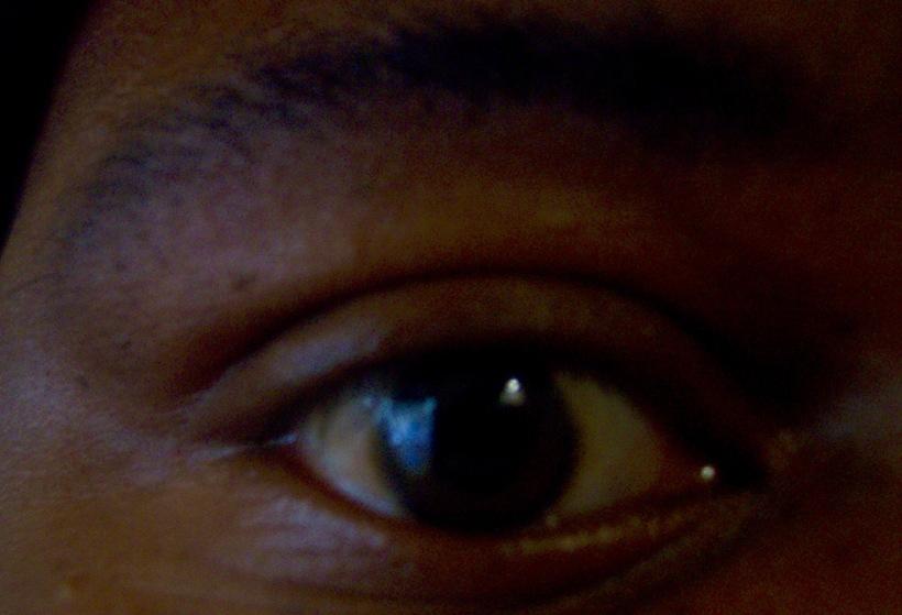 man's brown eye