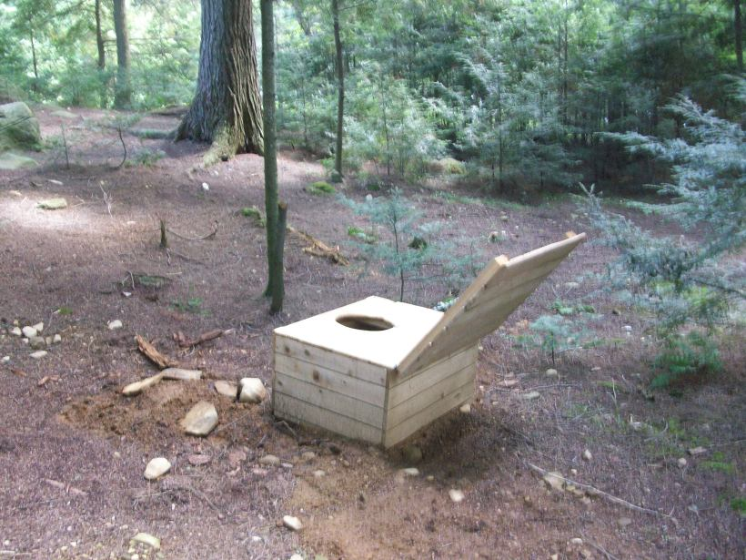 outdoor commode in woods