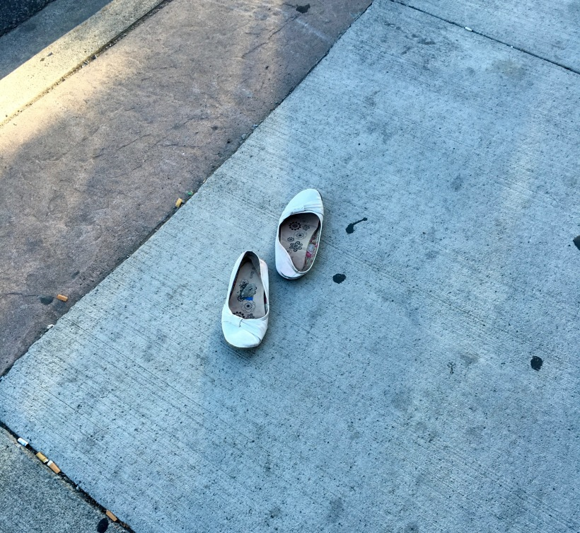 abandoned ladies loafers with cigarette butts