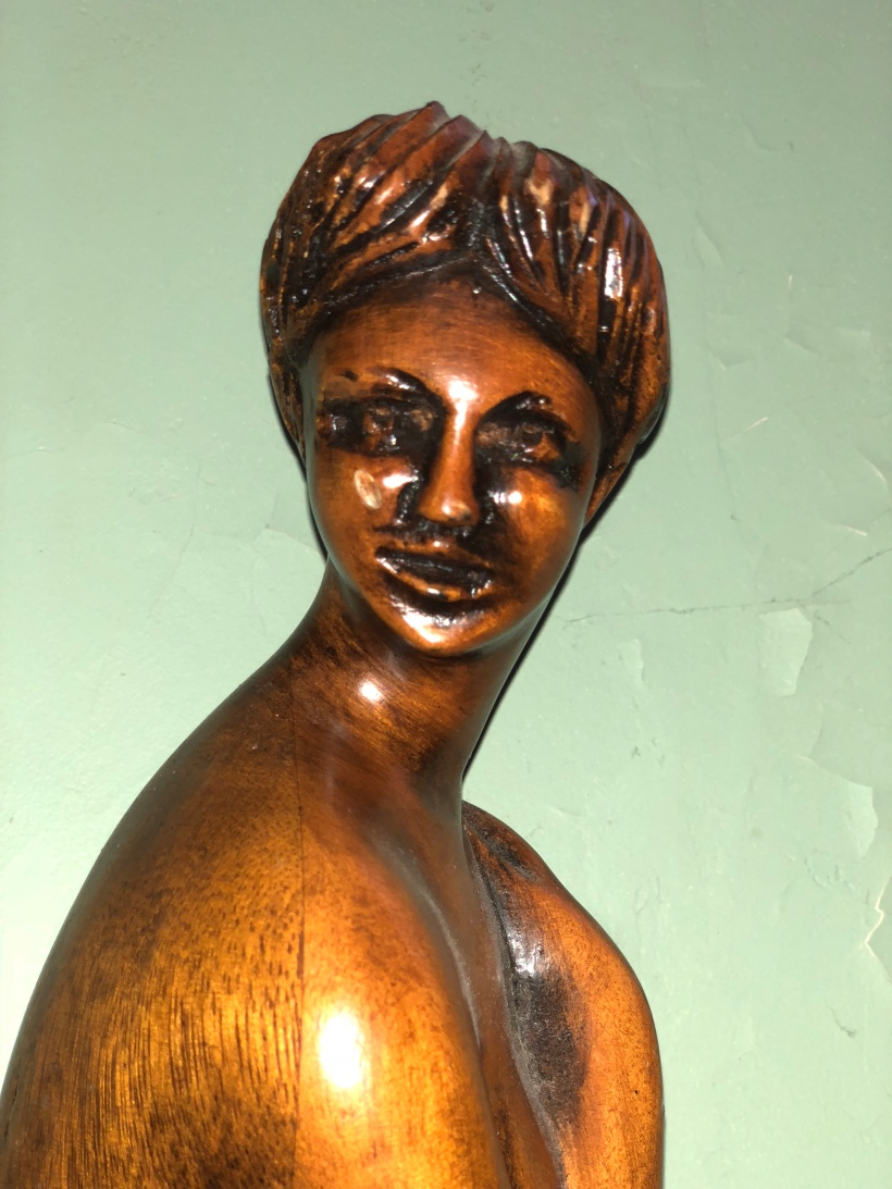Woman's face carved in wood
