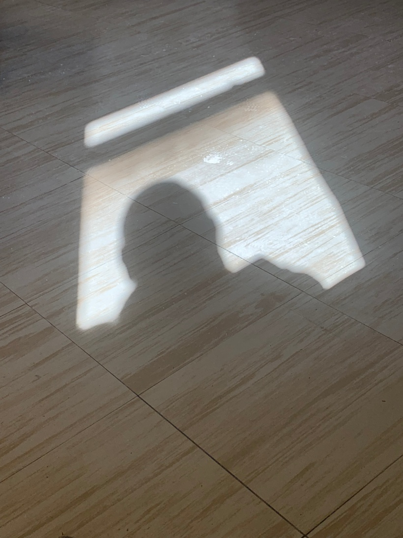 Shadow on a hospital waiting room floor.