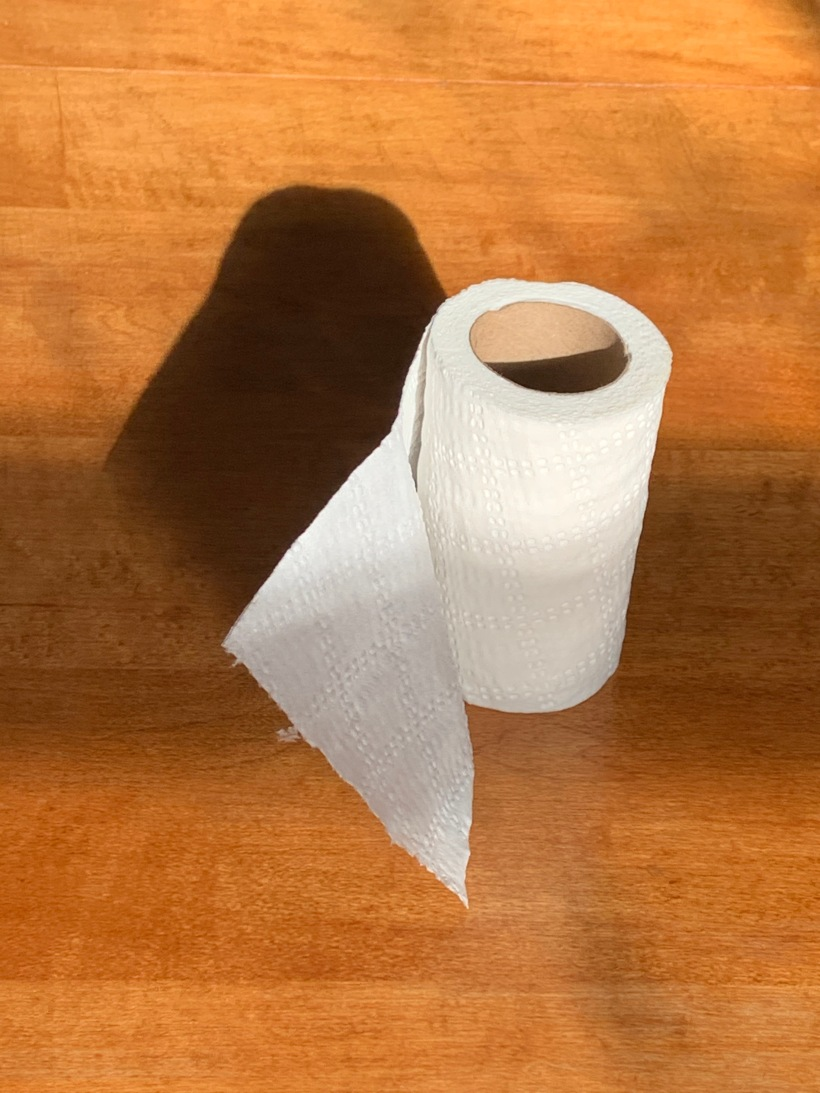 Toilet paper with shadow.